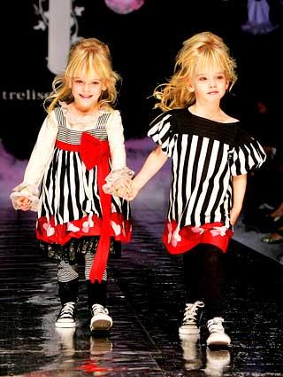 身穿新颖时尚服装的儿童成为舞台上的焦点.cfp供图